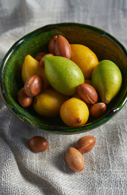 Fresh Argan nuts with outer skins and Argan nuts in their shells