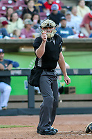 Home plate umpire Bobby Tassone makes a strike call during a game between the Quad Cities River Bandits and the Wisconsin Timber Rattlers on July 8, 2021 at Neuroscience Group Field at Fox Cities Stadium in Grand Chute, Wisconsin.  (Brad Krause/Four Seam Images)