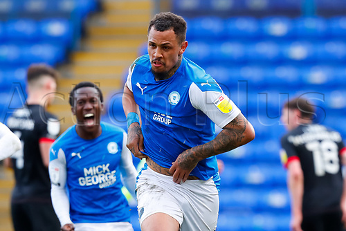 1st May 2021; Weston Homes Stadium, Peterborough, Cambridgeshire, England; English Football League One Football, Peterborough United versus Lincoln City; Jonson Clarke-Harris of Peterborough United celebrates his penalty kick goal after 95 minutes to level the game at 3-3 and guarantee Peterborough United automatic promotion to the EFL Championship