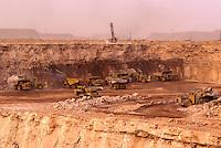 Arlit, Niger.  Heavy earth movers  excavating open-pit uranium mine.