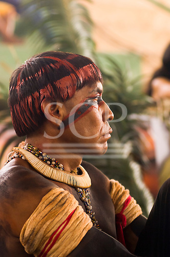 """Altamira, Brazil. """"Xingu Vivo Para Sempre"""" protest meeting about the proposed Belo Monte hydroeletric dam and other dams on the Xingu river and its tributaries. Indian from the Alto Xingu, Xingu Indigenous Park with full ceremonial body face and hair paint looking angry ."""