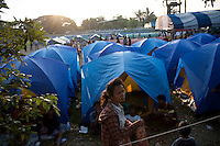 A refugee camp housing some of an estimated 20,000 Burmese refugees who had fled into Thailand to escape clashes in the border towns of Myawaddy and Pyaduangsu, only a day after a Burmese election which critics described as a sham..Ethnic minorities along the Thai-Burma border had warned earlier that the junta would launch a major offensive after the election, as many armed rebel groups had refused to become part of the government-controlled Border Guard Forces.