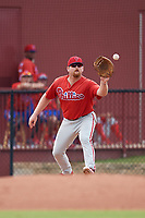 Philadelphia Phillies first baseman Quincy Nieporte (33) stretches to receive a throw during an Instructional League game against the Toronto Blue Jays on September 30, 2017 at the Carpenter Complex in Clearwater, Florida.  (Mike Janes/Four Seam Images)