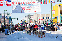 Dallas Seavey and team leave the ceremonial start line with an Iditarider and handler at 4th Avenue and D street in downtown Anchorage, Alaska on Saturday March 4th during the 2017 Iditarod race. Photo © 2017 by Brendan Smith/SchultzPhoto.com.