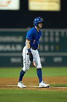 Jake Cronenworth (1) of the Durham Bulls takes his lead off of third base against the Louisville Bats at Durham Bulls Athletic Park on May 28, 2019 in Durham, North Carolina. The Bulls defeated the Bats 18-3. (Brian Westerholt/Four Seam Images)