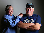 """Pam Babcock and her husband Larry Milbourn laugh during a portrait session at the Hynds Building on New Year's Eve. Milbourne said the small town feel of Cheyenne makes it a great place to raise he and Pam's 2 daughters. 'We love it. We are close to the mountains and we like hunting and fishing.' Said Milbourne. To participate in WTE Photo Editor Michael Smith's """"Our Faces: Portraits of Laramie County"""" project, call 633-3124 or 630-8388 or email msmith@wyomingnews.com to make an appointment. To see all of the portraits published so far, go online to ourfaces.wyomingnews.com. Michael Smith/staff"""