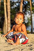 A Hawaiian child pauses while playing at 'Anaeho'omalu Beach near 'Anaeho'omalu Bay (or A-bay) in Waikoloa on the Big Island of Hawai'i.