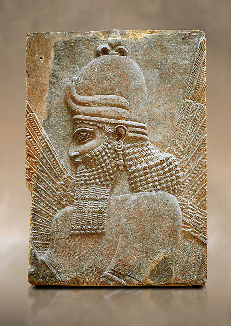 Stone relief sculptured panel fragment of a Genie blessing. Inv AO 19864/19880 from Dur Sharrukin the palace of Assyrian king Sargon II at Khorsabad, 713-706 BC.  Louvre Museum Room 4 , Paris