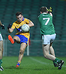 Eimhin Courtney of Clare  in action against Brian Fanning of Limerick during the Mc Nulty Cup U-21 final at The Gaelic Grounds. Photograph by John Kelly.