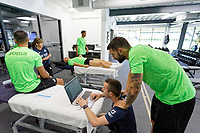 Pictured: Borja Baston (R) looks on the laptop screen with one of the physiotherapists. Thursday 27 June 2019<br /> Re: Swansea City FC players report for training at Fairwood training ground, UK
