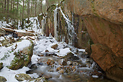 Small gorge on Cascade Brook in the Flume Gorge area of Franconia Notch in Lincoln, New Hampshire during the winter months.