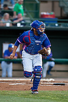 Catcher Sergio Burruel #13 of the Daytona Cubs throws to second base during the game against the Dunedin Blue Jays at Jackie Robinson Ballpark on April 11, 2012 in Daytona Beach, Florida. (Scott Jontes / Four Seam Images)