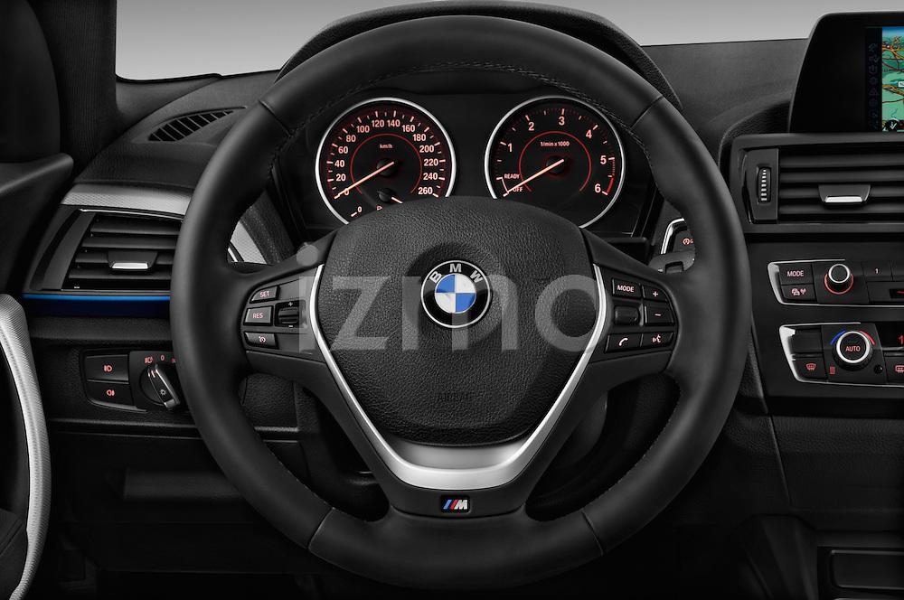 Steering wheel view of a 2012 - 2014 BMW 1-Series 118d M Sport 3 Door Hatchback 2WD.