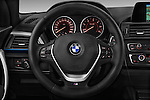 Steering wheel view of a 2012 - 2014 BMW 1-Series 118d M Sport 3 Door Hatchback 2WD.