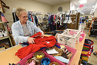 KNOW WHEN TO FOLD 'EM<br />Linda Sanders of Bella Vista, a volunteer at Care and Share thrift store in Gravette, folds donated clothes on Tuesday Jan. 12 2021 at the store located on on Arkansas 59 south of downtown Gravette. The store sells all kinds of items from hardware to clothing to electronics. It's affiliated with several churches in the Gravette area, Sanders said. Go to nwaonline.com/211013Daily/ to see more photos.<br />(NWA Democrat-Gazette/Flip Putthoff)