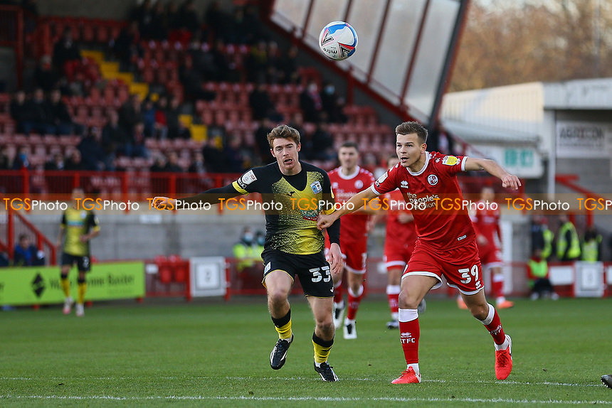 Luke James of Barrow AFC and Jake Hessenthaler of Crawley Town during Crawley Town vs Barrow, Sky Bet EFL League 2 Football at Broadfield Stadium on 12th December 2020