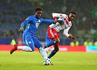 09.12.2017, Football 1. Bundesliga 2017/2018, 15.  match day, Hamburger SV - VfL Wolfsburg, Volksparkstadium Hamburg.  Divock Origi (Wolfsburg)  -  Gideon Jung (Hamburg)  *** Local Caption *** © pixathlon<br /> <br /> +++ NED + SUI out !!! +++<br /> Contact: +49-40-22 63 02 60 , info@pixathlon.de