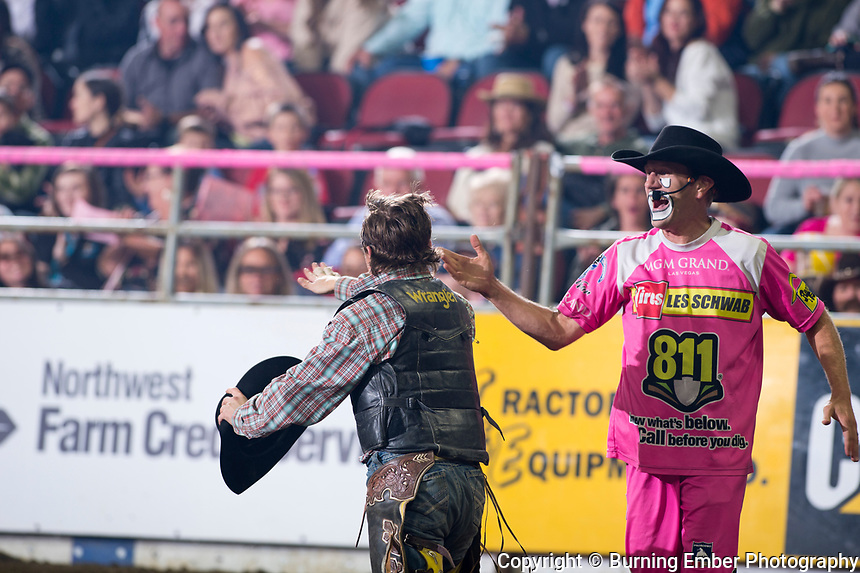 Logan Hay gets a high five from JJ Harrison at the NILE Rodeo 2nd Perf Oct 18th, 2019.  Photo by Josh Homer/Burning Ember Photography.  Photo credit must be given on all uses.