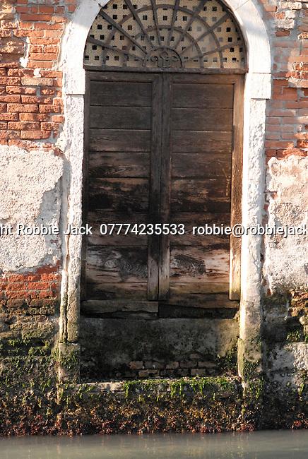 Doorway onto canal in Venice, Italy.