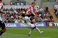 Npower Championship, Swansea City FC (white) V Sheffield United. Sat 7th May 2011 (12.45pm KO)<br /> Pictured:Swansea Nathan Dyer beaten by a high flying Shane Lowry<br /> Picture by: Ben Wyeth / Athena Picture Agency<br /> info@athena-pictures.com<br /> 07815 441513