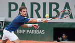 Diego Sebastian Schwartzman (ARG) loses to Roger Federer (SUI), 6-3, 6-4, 6-4 at  Roland Garros being played at Stade Roland Garros in Paris, France on May 28, 2014