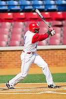 Troy Drummond #1 of the Delaware State Hornets follows through on his swing against the Georgetown Hoyas at Gene Hooks Field on February 26, 2011 in Winston-Salem, North Carolina.  Photo by Brian Westerholt / Four Seam Images