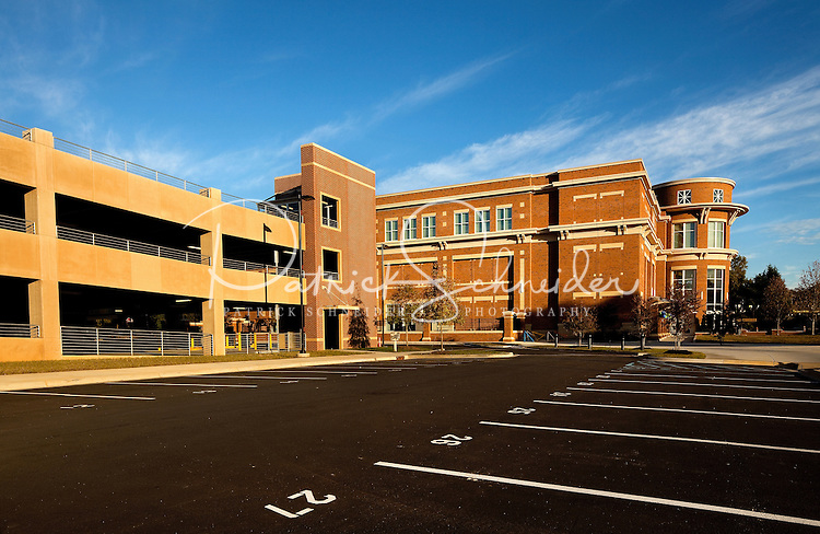 Exterior architectural photography (without people) of the Huntersville Town Center and Discovery Place Kids children's museum. The project, which opened to the public in October 2010, is a public-private venture in downtown Huntersville, North Carolina. View shows parking garage.