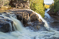 """""""Fall at Middle Falls""""<br /> The Gooseberry River rushes down a series of cascades and waterfalls on its way to Lake Superior. We reveled in the glow of the yellow birches during our hike up river."""