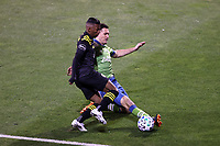 COLUMBUS, OH - DECEMBER 12: Shane O'Neill #27 of the Seattle Sounders FC tackles the ball away from Luis Diaz #12 of the Columbus Crew during a game between Seattle Sounders FC and Columbus Crew at MAPFRE Stadium on December 12, 2020 in Columbus, Ohio.