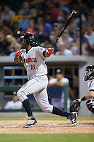 Josh Bell (18) of the Indianapolis Indians follows through on his swing against the Charlotte Knights at BB&T BallPark on June 17, 2016 in Charlotte, North Carolina.  The Knights defeated the Indians 4-0.  (Brian Westerholt/Four Seam Images)