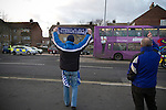 """Portsmouth 1 Southampton 1, 18/12/2012. Fratton Park, Championship. Portsmouth fans waving and gesturing to rival Southampton fans in a convoy of buses driving away from Fratton Park stadium after the teams Championship fixture against their local rivals. Around 3000 away fans were taken directly to the game in a fleet of buses in a police operation known as the """"coach bubble"""" to avoid the possibility of disorder between rival fans. The match ended in a one-all draw watched by a near capacity crowd of 19,879. Photo by Colin McPherson."""