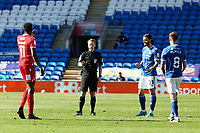 Referee James Garner (2nd L) speaks to (L-R) Sammy Ameobi of Nottingham Forest, Marlon Pack and Joe Ralls of Cardiff City before a free kick during the Sky Bet Championship match between Cardiff City and Nottingham Forest at the Cardiff City Stadium, Cardiff, Wales, UK. Friday 02 April 2021