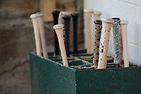 Baseball bats fill the bat rack in the Great Falls Voyagers dugout during the game against the Helena Brewers at Centene Stadium on August 19, 2017 in Helena, Montana.  The Voyagers defeated the Brewers 8-7.  (Brian Westerholt/Four Seam Images)