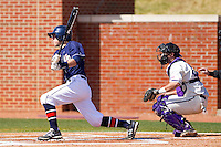Brian Blasik #18  of the Dayton Flyers follows through on his swing against the High Point Panthers at Willard Stadium on February 26, 2012 in High Point, North Carolina.    (Brian Westerholt / Four Seam Images)