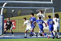 NWA Democrat-Gazette/CHARLIE KAIJO Players leap for a sideline shot during a soccer game, Friday, April 26, 2019 at  Whitey Smith Stadium at Rogers High School in Rogers.