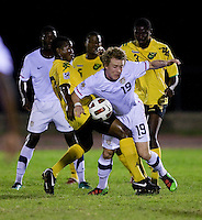 Jack McBean (19) of the United States is fouled by Romario Williams (7) of Jamaica during the semifinals of the CONCACAF Men's Under 17 Championship at Catherine Hall Stadium in Montego Bay, Jamaica. The United States defeated Jamaica, 2-0.
