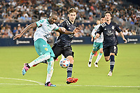 KANSAS CITY, KS - AUGUST 10: Andres Mosquera #4 Club Leon clears the ball during a game between Club Leon and Sporting Kansas City at Children's Mercy Park on August 10, 2021 in Kansas City, Kansas.