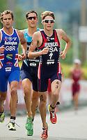 24 JUN 2012 - KITZBUEHEL, AUT - Lukas Verzbicas (USA) of USA (right, in blue and red) during the run at the elite men's 2012 World Triathlon Series round in Schwarzsee, Kitzbuehel, Austria .(PHOTO (C) 2012 NIGEL FARROW)
