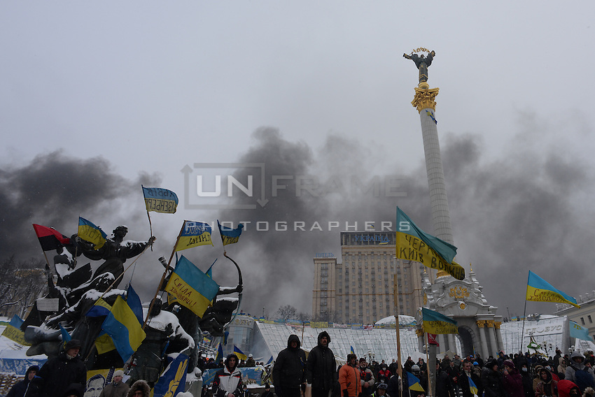 Every sculpture in Maidan (independence) Square has been given a Ukrainian flag in sign of protest.  Kiev. Ukraine
