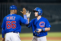 AZL Cubs catcher Marcus Mastrobuoni (5) receives a high five from assistant hitting coach Leonel Perez (66) after a fourth inning walk against the AZL Giants on September 6, 2017 at Sloan Park in Mesa, Arizona. AZL Giants defeated the AZL Cubs 6-5 to even up the Arizona League Championship Series at one game a piece. (Zachary Lucy/Four Seam Images)