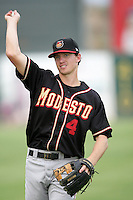 Joe Scott of the Modesto Nuts during game against the Lancaster JetHawks at Clear Channel Stadium in Lancaster,California on July 15, 2010. Photo by Larry Goren/Four Seam Images