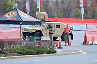 Landover, MD - March 24, 2020: Members of the Maryland National Guard Military Police secure the entrance to a COVID-19  health screening site in a parking lot at FedEx Field in Landover, MD, March 24, 2020. The site is not available for drive up screenings.  (Photo by Don Baxter/Media International)