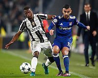 Calcio, Champions League: Gruppo H, Juventus vs Lione. Torino, Juventus Stadium, 2 novembre 2016. <br /> Juventus' Patrice Evra, left, is challenged by Lyon's Rachid Ghezzal during the Champions League Group H football match between Juventus and Lyon at Turin's Juventus Stadium, 2 November 2016. The game ended 1-1.<br /> UPDATE IMAGES PRESS/Isabella Bonotto