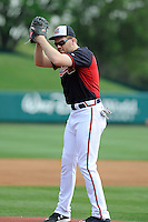 First baseman Freddie Freeman (5) of the Atlanta Braves mockingly delivers a pitch from the mound before a Spring Training game against the New York Yankees on Wednesday, March 18, 2015, at Champion Stadium at the ESPN Wide World of Sports Complex in Lake Buena Vista, Florida. The Yankees won, 12-5. (Tom Priddy/Four Seam Images)
