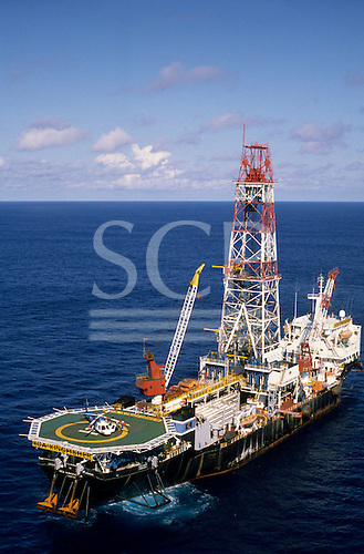Rio de Janeiro, Brazil. KCA Kingfisher, a Petrobras drilling ship in the Campos Basin with helipad with helicopter.