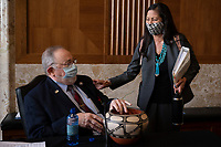 United States Representative Deb Haaland (Democrat of New Mexico), delivers a gift to US Representative Don Young (Republican of Alaska), during the Senate Committee on Energy and Natural Resources hearing on her nomination to be Interior Secretary on Capitol Hill in Washington, DC, on February 23, 2021.<br /> Credit: Jim Watson / Pool via CNP /MediaPunch