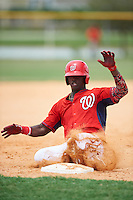 GCL Nationals right fielder Israel Mota (24) slides into third base during a game against the GCL Astros on August 14, 2016 at the Carl Barger Baseball Complex in Viera, Florida.  GCL Nationals defeated GCL Astros 8-6.  (Mike Janes/Four Seam Images)