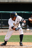 Emerson Landoni #12 of the Charleston RiverDogs batting in a game against the West Virginia Power on April 14, 2010  in Charleston, SC.