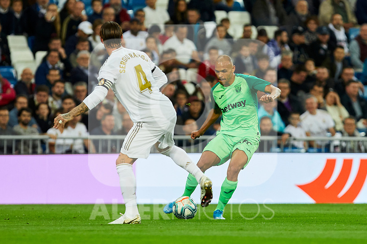 Sergio Ramos of Real Madrid and Martin Braithwaite  of CD Leganes during La Liga match between Real Madrid and CD Leganes at Santiago Bernabeu Stadium in Madrid, Spain. October 30, 2019. (ALTERPHOTOS/A. Perez Meca)