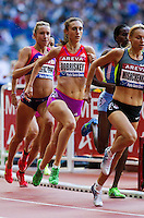 06 JUL 2012 - PARIS, FRA - Lisa Dobriskey of Great Britain (centre) runs in the lead pack during the women's 1500m race at the 2012 Meeting Areva athletics meet held in the Stade de France in Paris, France (PHOTO (C) 2012 NIGEL FARROW)
